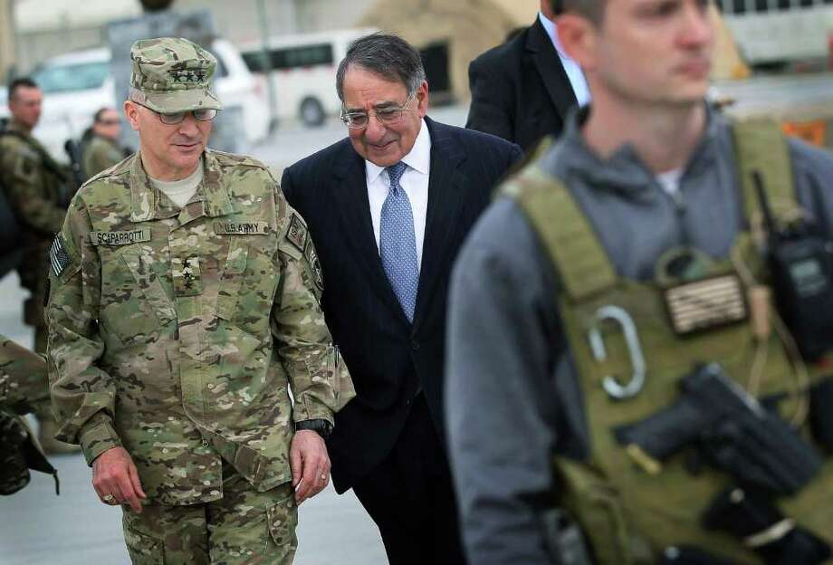 Gen. Curtis Scaparrotti, who has banned American troops in Korea from buying drinks for 'bar girls,' with former U.S. Defense Secretary Leon Panetta.  (AP Photo/Scott Olson, Pool) Photo: Scott Olson / Pool, Getty Images Europe