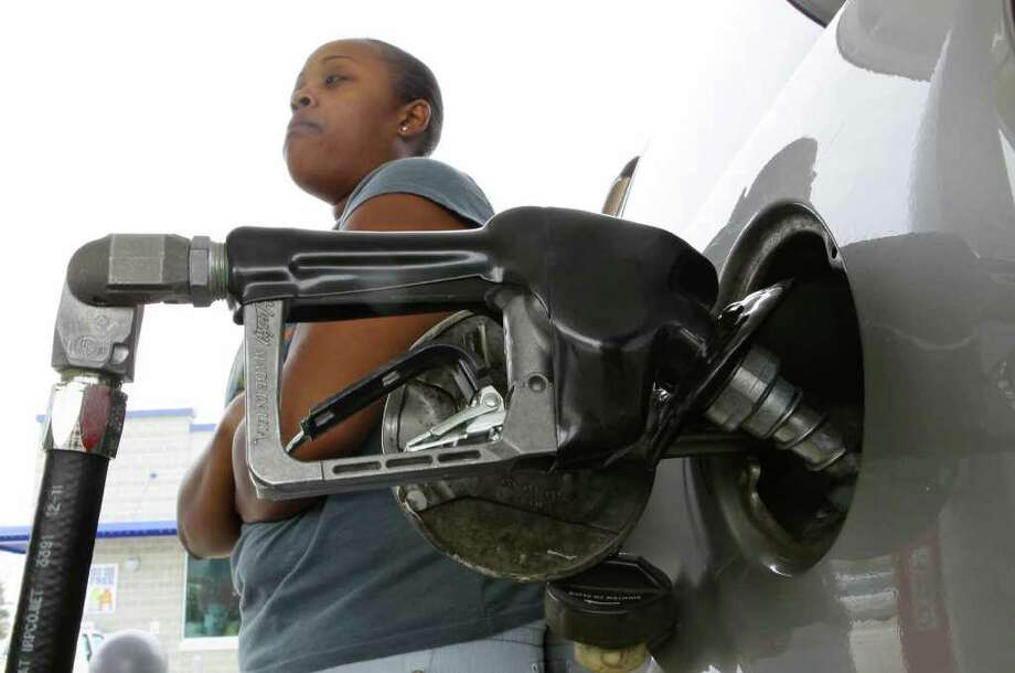 Jawanna Smith, of Anderson, S.C., fills her car with fuel, Monday, March 12, 2012, at the newly opened Spinx station on the corner of S.C. 28 bypass and S.C. 24 in Anderson, S.C. Photo: AP