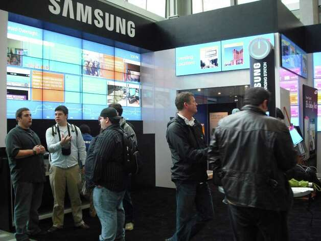 South by Southwest Interactive attendees visit the Samsung space at Austin Convention Center. Photo: Edmond Ortiz / North Central News