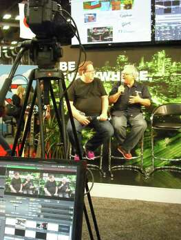 Jeff Pulver (left) and Alan Weinkrantz talk social and new media companies in the NewTek booth at the South by Southwest Interactive trade show. Photo: Edmond Ortiz / North Central News