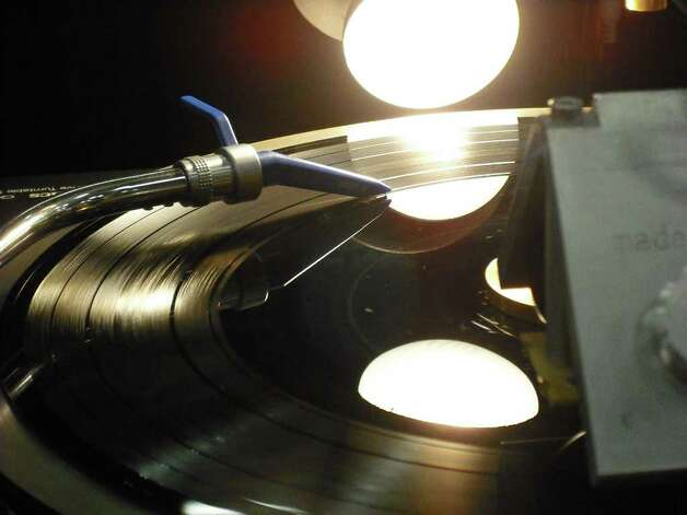 A needle cuts a groove into a record, storing musical data from a CD into the vinyl disc, in the VinylRecorder.com booth at the South by Southwest Interactive trade show. Photo: Edmond Ortiz / North Central News