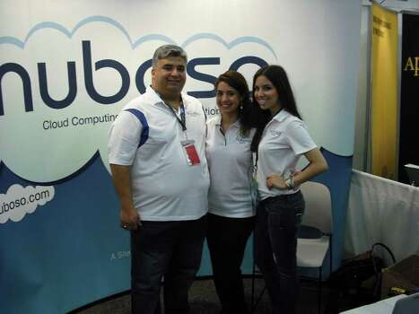 Fred Reyes, Nuboso co-founder (from left), poses with Carolina Barrera, Nuboso's lead support engineer, and  Lauren Pena of Aguillon and Associates at Nuboso's booth at the South by Southwest Interactive trade show. Photo: Edmond Ortiz / North Central News