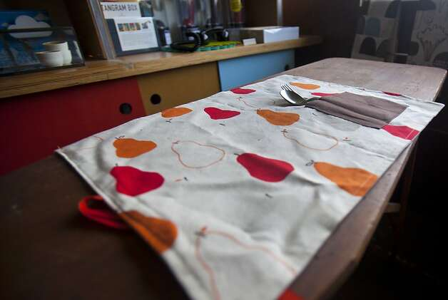 A place mat for family dining rests on a bench inside of The Curiosity Shop in San Francisco on Sunday. Lauren Smith and Derek Fagerstrom, owners of The Curiosity Shop in San Francisco, are putting together a craft workshop for the National Day of Unplugging that will teach participants to make place mats for family dining and sleeping bags for cellphones. Photo: Kevin Johnson, The Chronicle