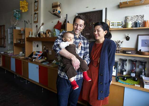 Lauren Smith and Derek Fagerstrom stand inside of The Curiosity Store in San Francisco with their son Arrow Fagerstrom, 1. Smith and Fagerstrom are the owners of The Curiosity Shop in San Francisco, and are putting together a craft workshop for the National Day of Unplugging. The workshop will teach participants to make place mats for family dining and sleeping bags for cellphones. Photo: Kevin Johnson, The Chronicle