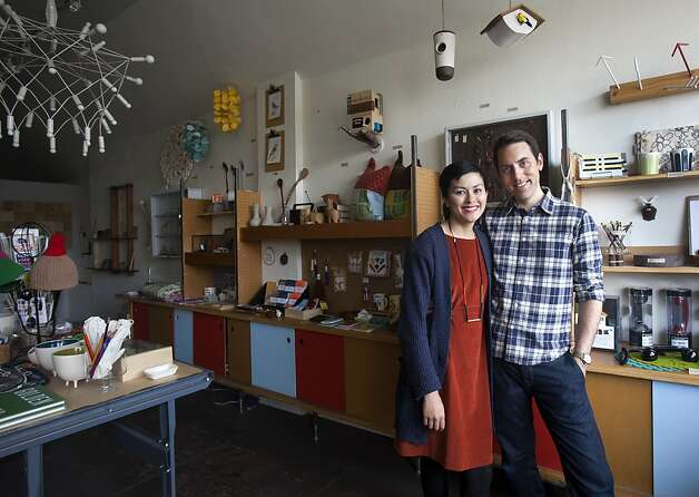Lauren Smith and Derek Fagerstrom stand inside of their store, The Curiosity Shop, in San Francisco on Sunday. The couple are putting together a craft workshop for the National Day of Unplugging that will teach participants to make place mats for family dining and sleeping bags for cellphones. Photo: Kevin Johnson, The Chronicle