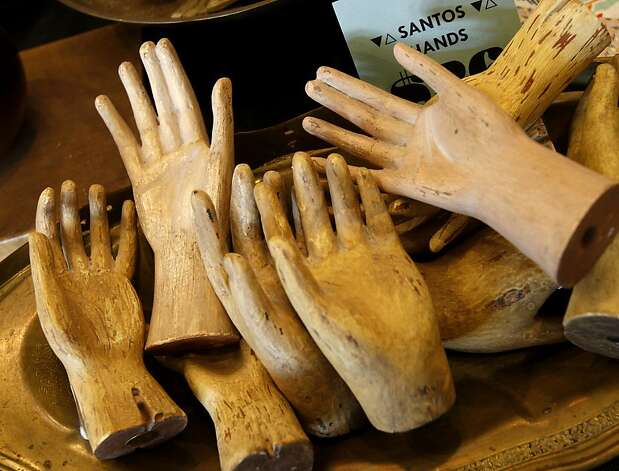You can purchase another set of hands in a home decor area of Belljar on 16th Street. An area of San Francisco's Mission district around Valencia Street yields some exciting furniture and decor stores all within walking distance of each other. Photo: Brant Ward, The Chronicle
