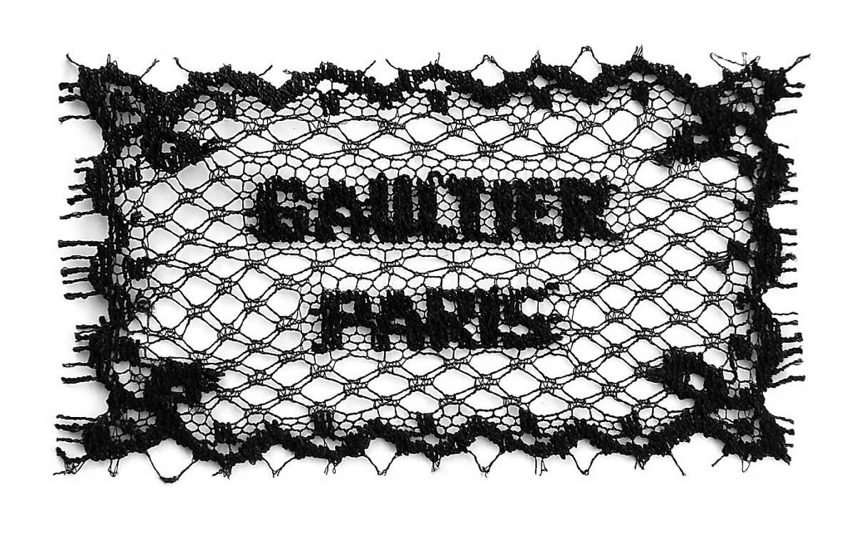 Images from the Jean Paul Gaultier exhibit catalog. A Gaultier Paris lace label, for haute couture.