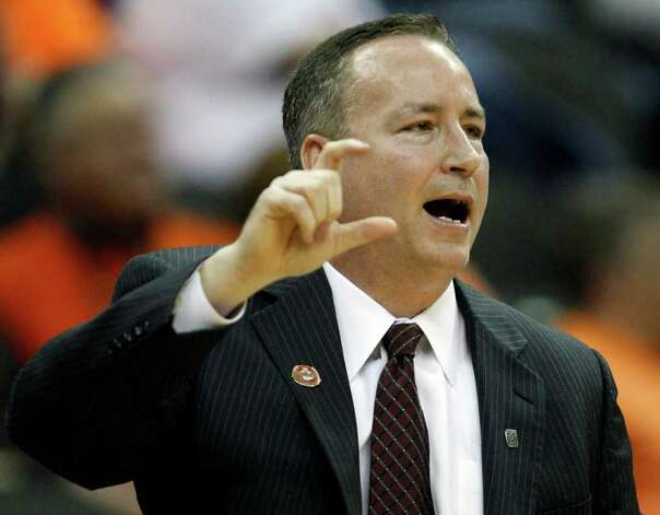 Texas A&M coach Billy Kennedy signals during the second half of an NCAA college basketball game against Oklahoma in the Big 12 Conference tournament, Wednesday, March 7, 2012, in Kansas City, Mo. Photo: AP