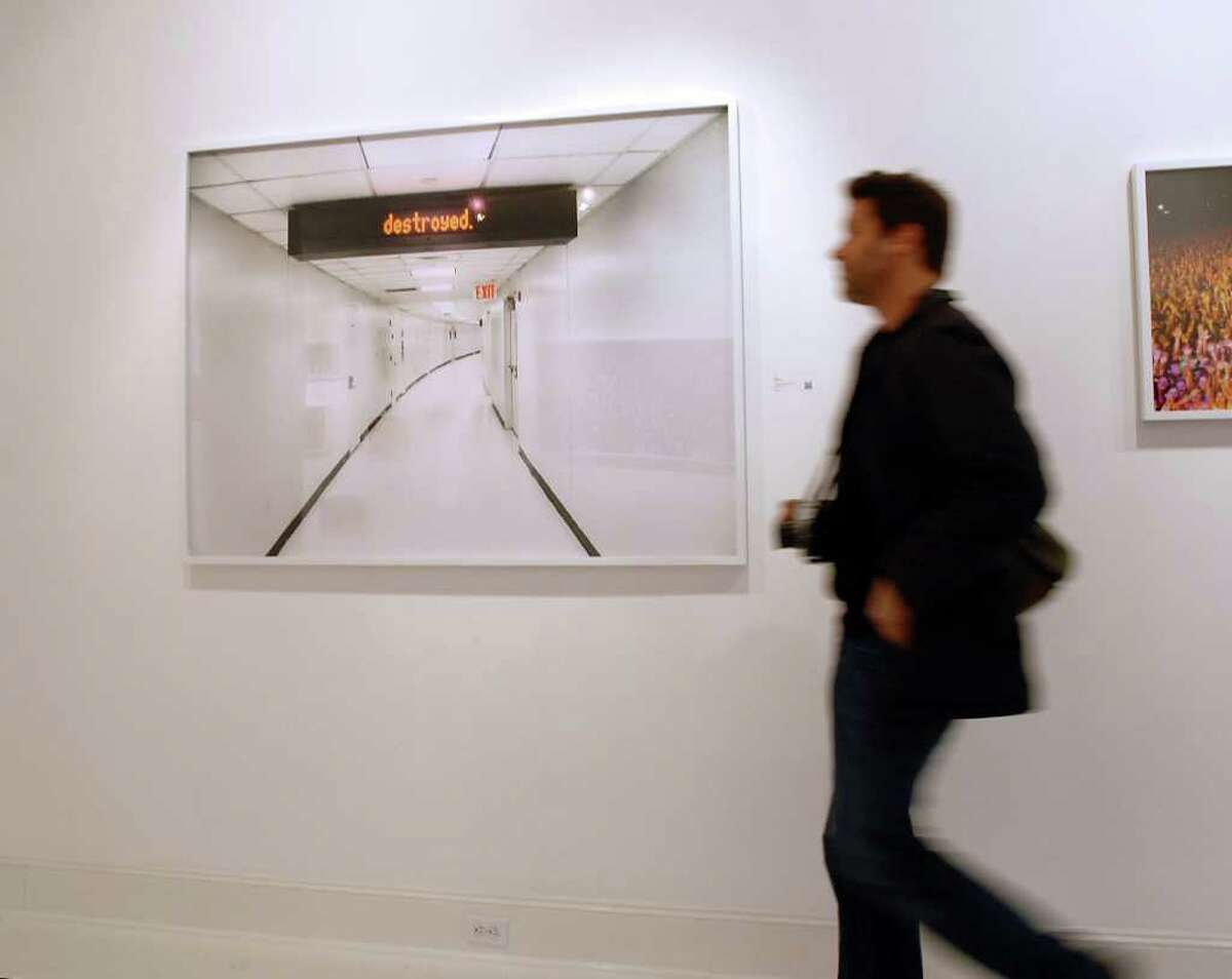 """Photographic exhibition by musician and photographer Moby who was signing copies of his new photo book """"destroyed,"""" at Samuel Owen Gallery in Greenwich Thursday, March 15, 2012."""