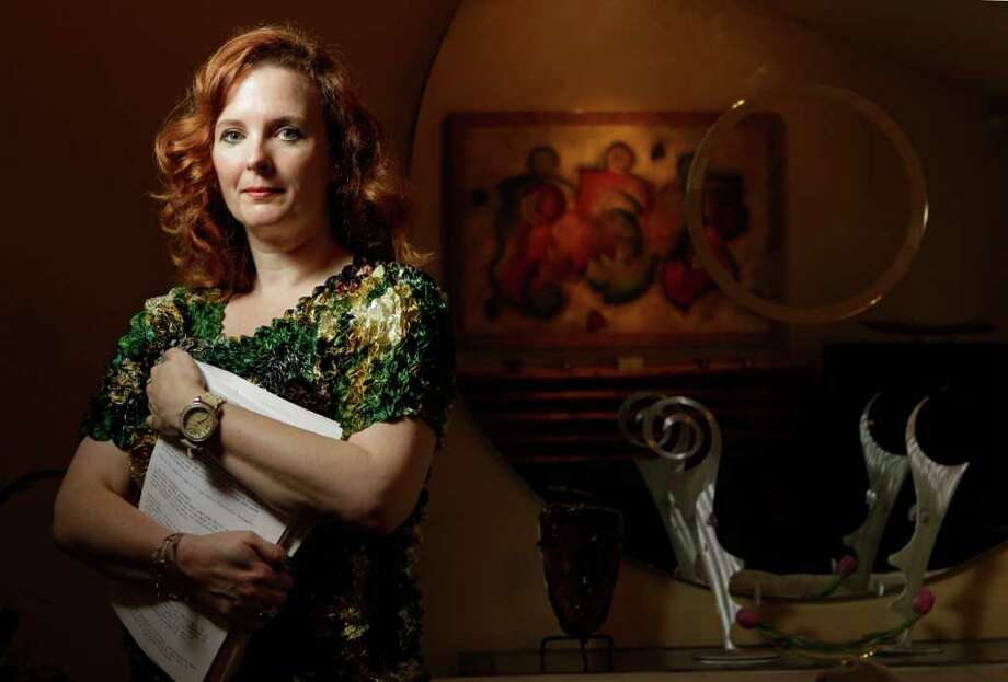 Stacy Ryan, a Houston marketing consultant, says a thief stole her identity and filed a fraudulent income tax return to steal her refund. The IRS says such fraud is a fast-growing problem. Photo: Melissa Phillip, Houston Chronicle / © 2012 Houston Chronicle