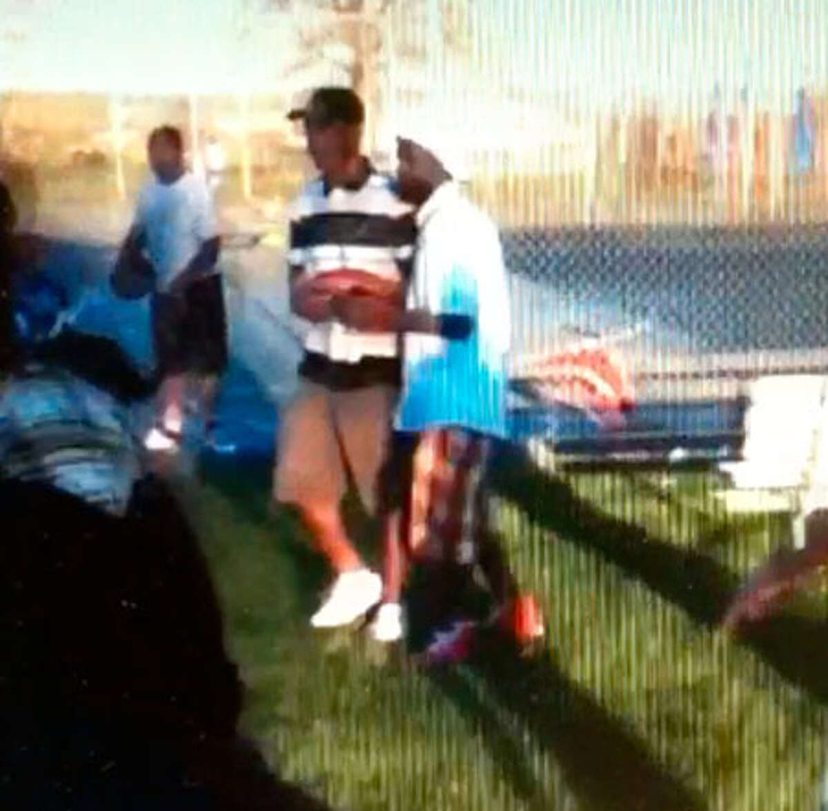Frame grab from cellphone video showing Dhoruba Shuaib left in striped shirt who is accused of aiding Jah-Lah Vanderhorst right in the fatal stabbing of Tyler Rhodes last year in Albany?s Hoffman Park. (Albany County Court evidence video)