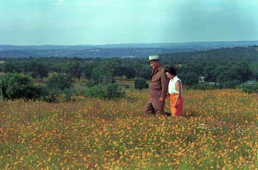 President Lyndon B. Johnson and first lady Lady Bird Johnson take in  the wildflowers at the LBJ Ranch near Stonewall on July 5, 1968. Photo: Frank Wolfe, Ho / LBJ Library