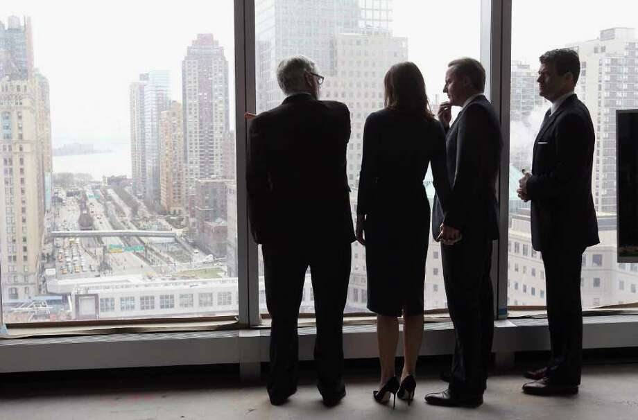 British Prime Minister David Cameron (2nd R) stands with his wife Samantha (2nd L) while gazing over Ground Zero from the 21st floor of One World Trade on March 15, 2012 in New York, New York. The Camerons paid homage to victims of the terrorist attacks of September 11, 2001 whilst on the third and final day of their official visit to the United States. Photo: John Moore, Getty Images / 2012 Getty Images