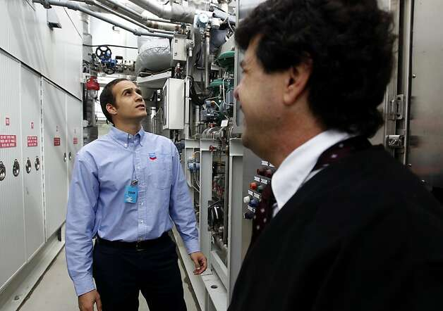 Osama Idrees (left), project manager of the alternative energy system at the Santa Rita Jail facility, works with Matt Muniz, the energy program director for Alameda County, in the fuel cell power plant at the jail in Dublin, Calif. on Thursday, March 15, 2012. Photo: Paul Chinn, The Chronicle