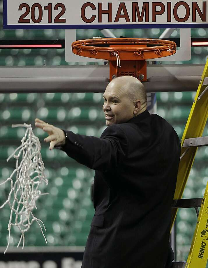 FILE - In this March 5, 2012, file photo, Saint Mary's coach Randy Bennett throws the net to his players after cutting it down after beating Gonzaga 78-74  in overtime in an NCAA college basketball game in the championship of the West Coast Conference tournament in Las Vegas.  (AP Photo/Julie Jacobson, File) Photo: Julie Jacobson, Associated Press