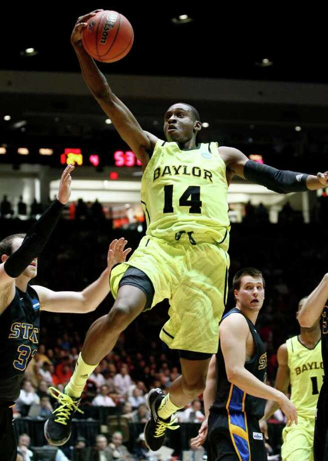 Baylor guard Deuce Bello (14) drives the lane against South Dakota State during the first half of an NCAA men's college basketball tournament second-round game Thursday, March 15, 2012, in Albuquerque, N.M. (AP Photo/Matt York) Photo: Matt York / AP