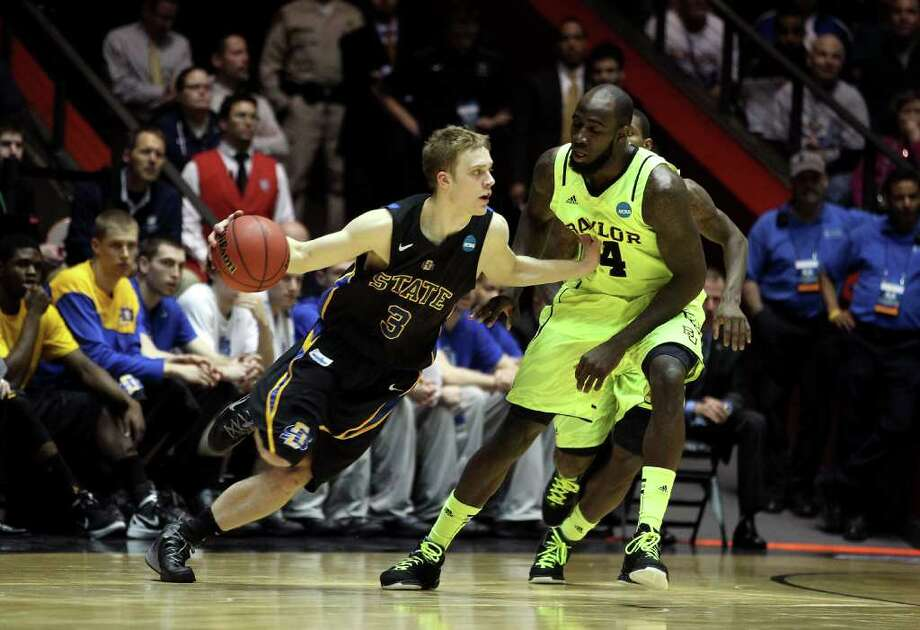 ALBUQUERQUE, NM - MARCH 15: Nate Wolters #3 of the South Dakota State Jackrabbits handles the ball against Quincy Acy #4 of the Baylor Bears during the second round of the 2012 NCAA Men's Basketball Tournament at The Pit on March 15, 2012 in Albuquerque, New Mexico. Photo: Christian Petersen, Getty Images / 2012 Getty Images