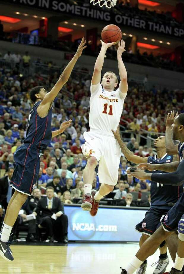 LOUISVILLE, KY - MARCH 15:  Scott Christopherson #11 of the Iowa State Cyclones drives for a shot attempt in the first half against Shabazz Napier #13 of the Connecticut Huskies during the second round of the 2012 NCAA Men's Basketball Tournament at KFC YUM! Center on March 15, 2012 in Louisville, Kentucky. Photo: Andy Lyons, Getty Images / 2012 Getty Images