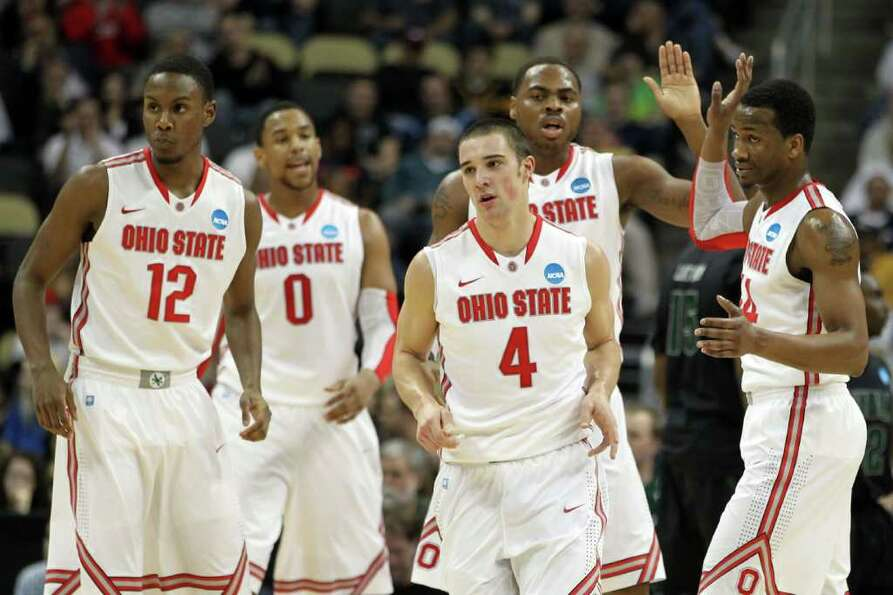 PITTSBURGH, PA - MARCH 15:  Deshaun Thomas #1 of the Ohio State Buckeyes high-fives teammate William