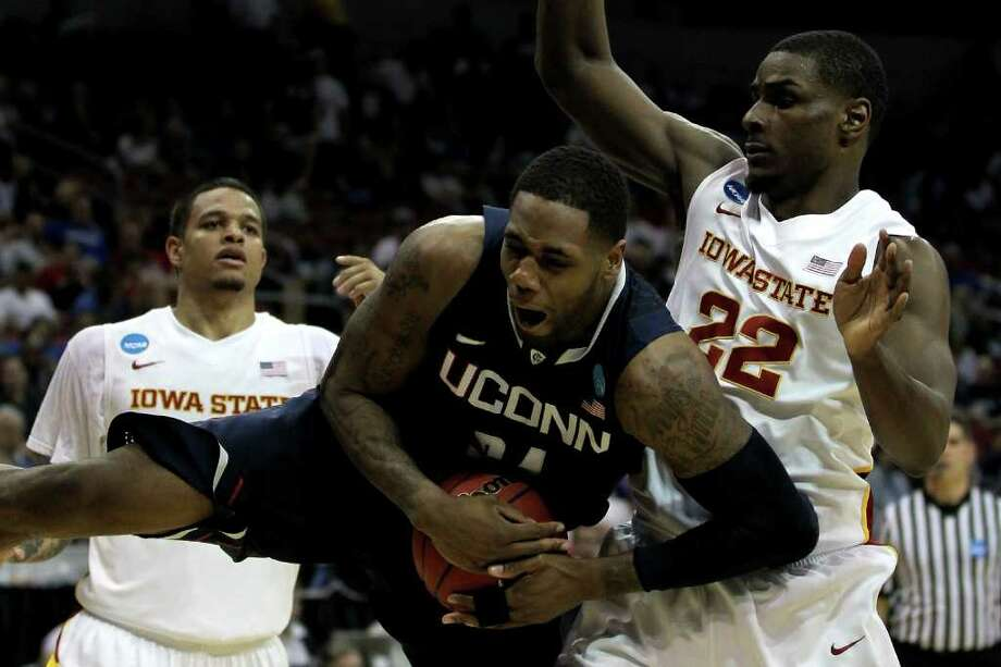 LOUISVILLE, KY - MARCH 15:  Alex Oriakhi #34 of the Connecticut Huskies controls the ball in the first half against Anthony Booker #22 of the Iowa State Cyclones during the second round of the 2012 NCAA Men's Basketball Tournament at KFC YUM! Center on March 15, 2012 in Louisville, Kentucky. Photo: Jonathan Daniel, Getty Images / 2012 Getty Images