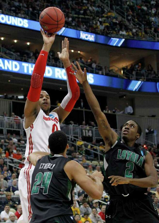 Ohio State's Jared Sullinger (0) shoots over Loyola of Maryland's Erik Etherly (24) and Justin Drummond (2) in the first half of an NCAA tournament second-round college basketball game on Thursday, March 15, 2012, in Pittsburgh.  (AP Photo/Keith Srakocic) Photo: Keith Srakocic, Associated Press / AP