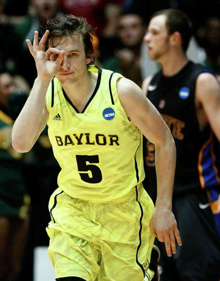 Mar. 15: Baylor guard Brady Heslip (5) gestures after hitting a 3-pointer against South Dakota State. Photo: Matt York, Associated Press / AP