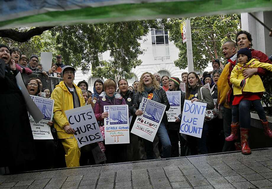Teachers and their supporters rallied on the steps of the San Francisco Schools district building on Franklin Street in San Francisco, Calif. A spirited demonstration outside of the San Francisco School district offices by teachers and their supporters moved inside and disrupted the scheduled Board of Education meeting Tuesday March 13, 2012. Protesters are upset with upcoming layoffs and the Superintendent's Zone plan. Photo: Brant Ward, The Chronicle