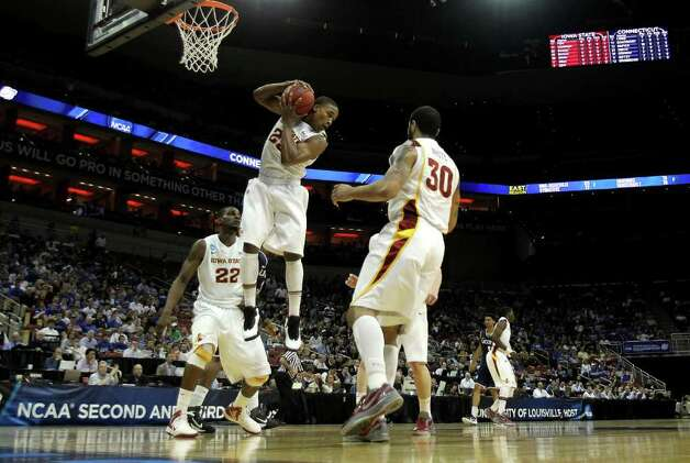 LOUISVILLE, KY - MARCH 15:  Tyrus McGee #25 of the Iowa State Cyclones controls a rebound in the first half against the Connecticut Huskies during the second round of the 2012 NCAA Men's Basketball Tournament at KFC YUM! Center on March 15, 2012 in Louisville, Kentucky.  (Photo by Jonathan Daniel/Getty Images) Photo: Jonathan Daniel, Getty Images / 2012 Getty Images