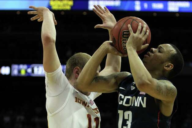 LOUISVILLE, KY - MARCH 15:  Shabazz Napier (L) #13 of the Connecticut Huskies is fouled in the first half by Scott Christopherson #11 of the Iowa State Cyclones during the second round of the 2012 NCAA Men's Basketball Tournament at KFC YUM! Center on March 15, 2012 in Louisville, Kentucky.  (Photo by Jonathan Daniel/Getty Images) Photo: Jonathan Daniel, Getty Images / 2012 Getty Images