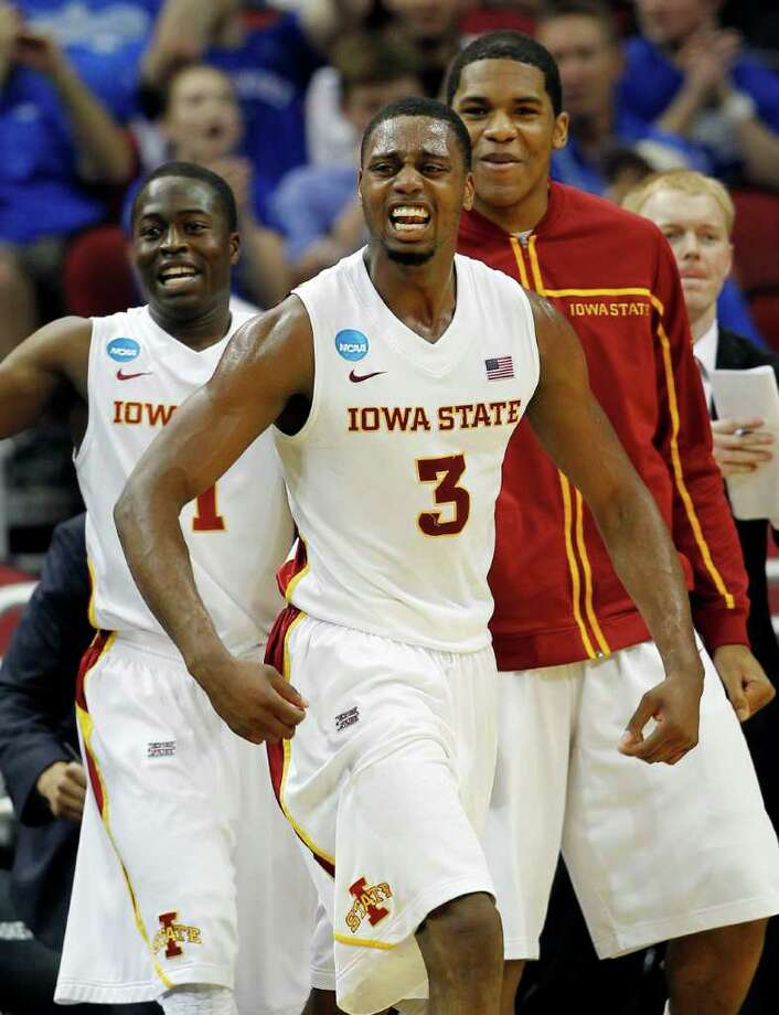 Iowa State forward Melvin Ejim (3) and guard Bubu Palo, left, react with teammates after a 3-pointer against Connecticut in the first half of their NCAA tournament second-round college basketball game in Louisville, Ky., Thursday, March 15, 2012. (AP Photo/John Bazemore) Photo: John Bazemore, Associated Press / AP
