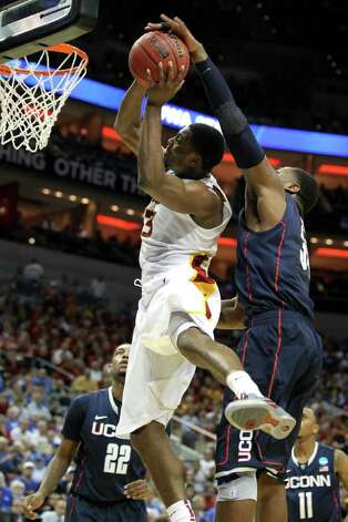 LOUISVILLE, KY - MARCH 15:  Melvin Ejim #3 of the Iowa State Cyclones drives for a shot attempt in the first half against the Alex Oriakhi #34 of the Connecticut Huskies during the second round of the 2012 NCAA Men's Basketball Tournament at KFC YUM! Center on March 15, 2012 in Louisville, Kentucky.  (Photo by Andy Lyons/Getty Images) Photo: Andy Lyons, Getty Images / 2012 Getty Images