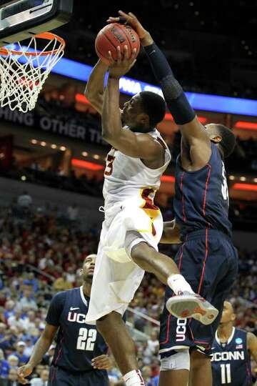 LOUISVILLE, KY - MARCH 15:  Melvin Ejim #3 of the Iowa State Cyclones drives for a shot attempt in t