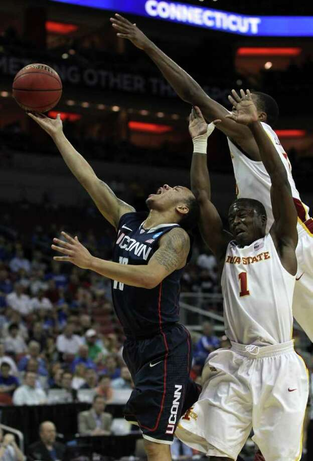 LOUISVILLE, KY - MARCH 15:  Shabazz Napier #13 of the Connecticut Huskies drives for a shot attempt against Bubu Palo #1 of the Iowa State Cyclones during the second round of the 2012 NCAA Men's Basketball Tournament at KFC YUM! Center on March 15, 2012 in Louisville, Kentucky.  (Photo by Jonathan Daniel/Getty Images) Photo: Jonathan Daniel, Getty Images / 2012 Getty Images