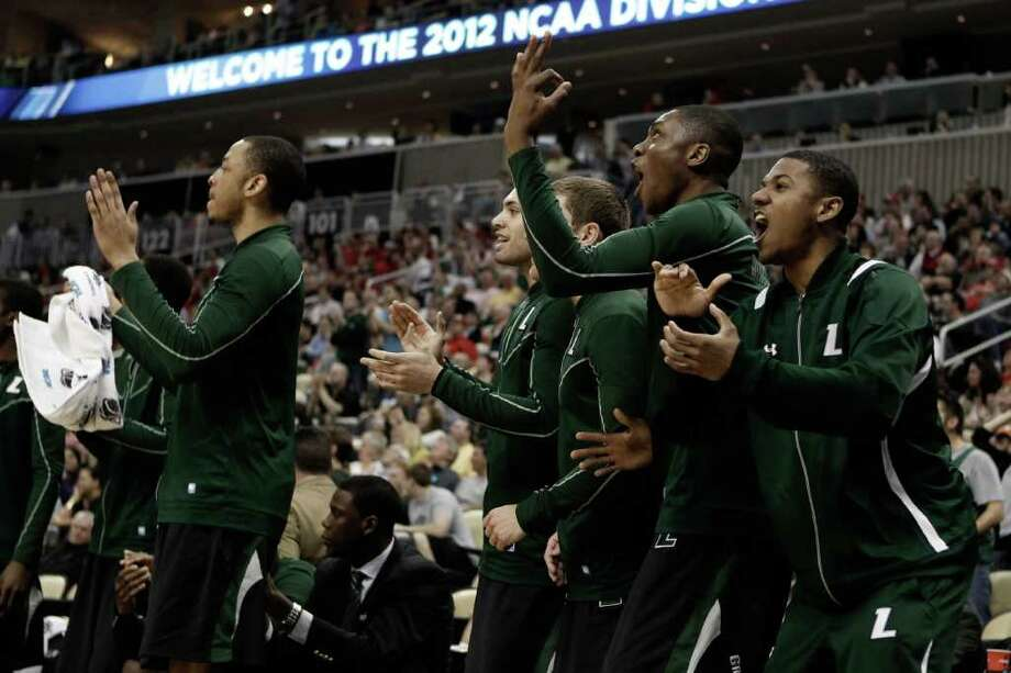 PITTSBURGH, PA - MARCH 15: The Loyola Greyhounds bench celebrates after a play on court against the Ohio State Buckeyes during the second round of the 2012 NCAA Men's Basketball Tournament at Consol Energy Center on March 15, 2012 in Pittsburgh, Pennsylvania. Photo: Jared Wickerham, Getty Images / 2012 Getty Images