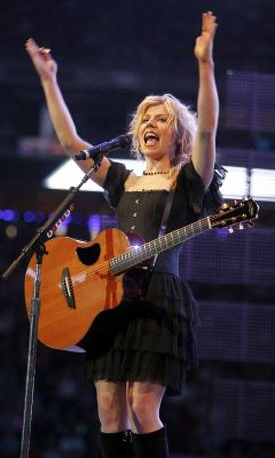 Kimberly Perry with The Band Perry performs in concert at RodeoHouston on March 14.  (James Nielsen / Chronicle)