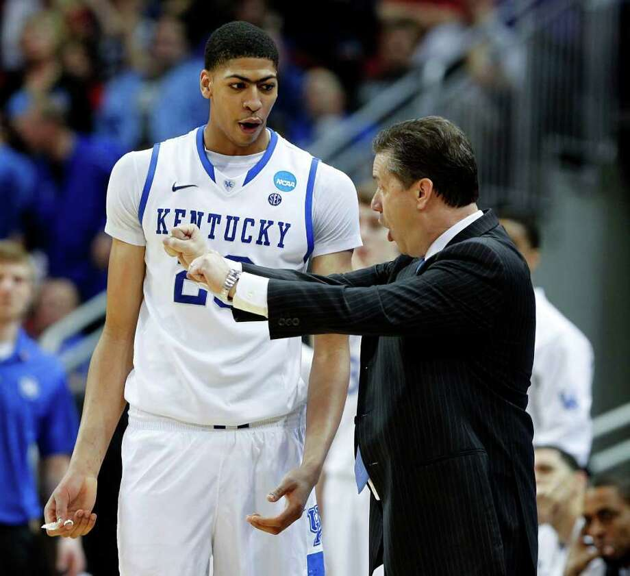 Kentucky coach John Calipari talked to Anthony Davis, who was called for a technical during second half action in the NCAA Men's Basketball Tournament on Thursday, March 15, 2012, in Louisville, Kentucky. The Kentucky Wildcats defeated the Western Kentucky Hilltoppers, 81-66. (Charles Bertram/Lexington Herald-Leader/MCT) Photo: Charles Bertram, McClatchy-Tribune News Service / Lexington Herald-Leader