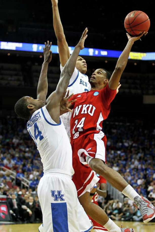 Western Kentucky Hilltoppers forward Stephon Drane (24) was blocked by Kentucky Wildcats forward Michael Kidd-Gilchrist (14) and Anthony Davis, back, in the NCAA Men's Basketball Tournament on Thursday, March 15, 2012, in Louisville, Kentucky. The Kentucky Wildcats defeated the Western Kentucky Hilltoppers, 81-66. (Mark Cornelison/Lexington Herald-Leader/MCT) Photo: Mark Cornelison, McClatchy-Tribune News Service / Lexington Herald-Leader