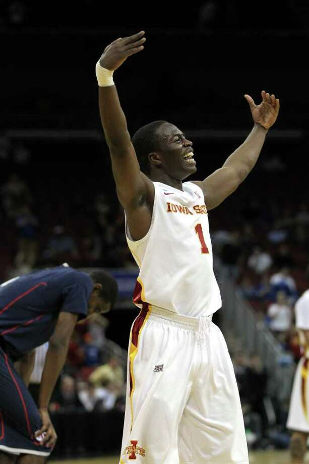 LOUISVILLE, KY - MARCH 15:  Bubu Palo #1 of the Iowa State Cyclones celebrates after they won 77-64 against the Connecticut Huskies during the second round of the 2012 NCAA Men's Basketball Tournament at KFC YUM! Center on March 15, 2012 in Louisville, Kentucky.  (Photo by Jonathan Daniel/Getty Images) Photo: Jonathan Daniel, Getty Images / 2012 Getty Images