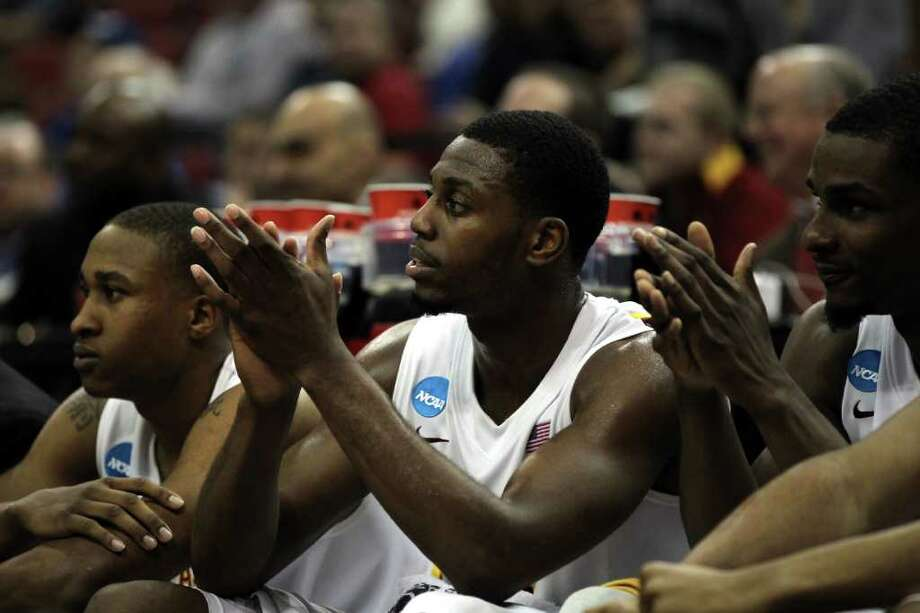LOUISVILLE, KY - MARCH 15:  Melvin Ejim #3 (C) of the Iowa State Cyclones supports his teammates from the bench against the Connecticut Huskies during the second round of the 2012 NCAA Men's Basketball Tournament at KFC YUM! Center on March 15, 2012 in Louisville, Kentucky. Photo: Jonathan Daniel, Getty Images / 2012 Getty Images