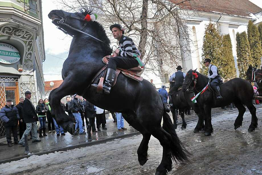 TOPSHOTSMen on horseback take part in a parade on Hungary's National Day in Targu Secuiesc, north of Bucharest on March 15, 2012. Thousands of ethnic Hungarians from the central Transylvanian region of Romania gather in a celebration in Targu Secuiesc to mark the 1848 Hungarian Revolution.    TOPSHOTS/AFP PHOTO / DANIEL MIHAILESCU (Photo credit should read DANIEL MIHAILESCU/AFP/Getty Images) Photo: Daniel Mihailescu, AFP/Getty Images