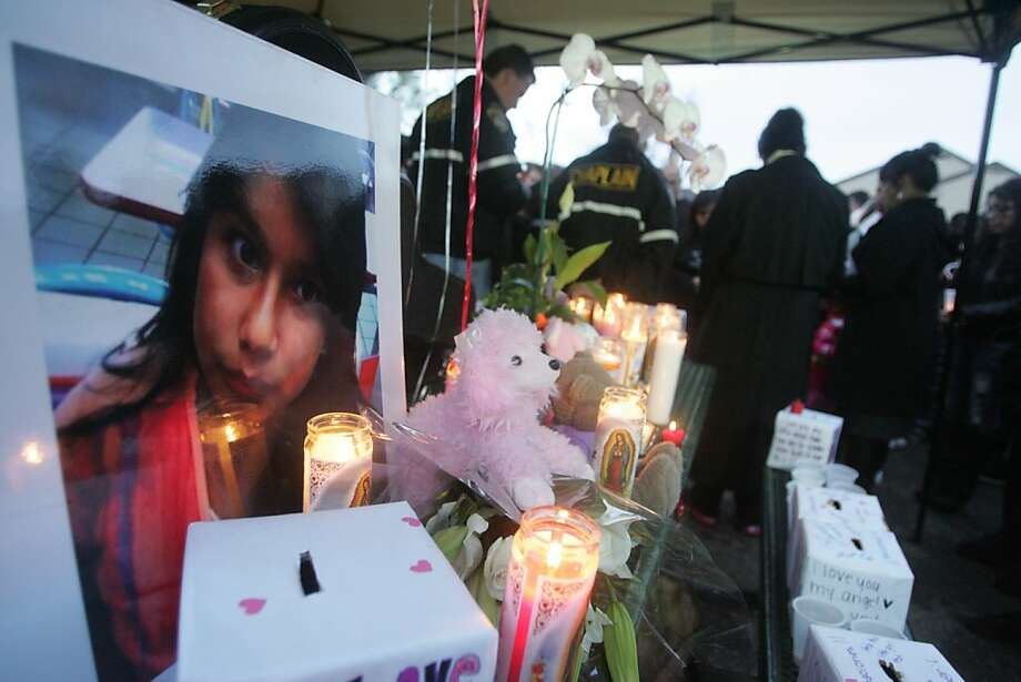 Mourners hold a moment of silence at a memorial  for Lucero Gutierrez, 11, on Thursday, March 15, 2012 in Gilroy, Calif. Guitierrez was apparently shot and killed by her brother Abel Gutierrez, an Iraq war veteran, who then shot himself on Wednesday. Photo: Mathew Sumner, Special To The Chronicle