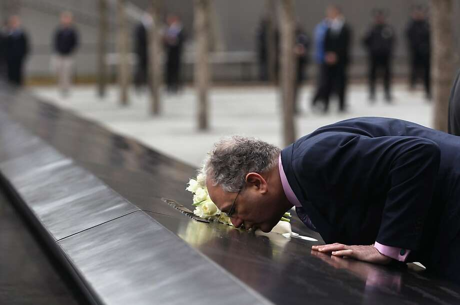 NEW YORK, NY - MARCH 15:  Charles Wolf kisses the name of his wife Katherine Wolf, a British citizen who died at Ground Zero during the 9/11 attacks at the World Trade Center Memorial on March 15, 2012 in New York, New York. He accompanied British Prime Minister David Cameron and his wife Samantha on their visit to the site.  (Photo by John Moore/Getty Images)  *** BESTPIX *** Photo: John Moore, Getty Images