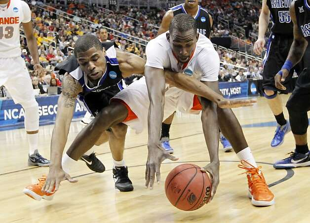 UNC-Asheville's Jaron Lane, left, and Syracuse's Baye Keita, reach for a loose ball in the first half of an East Regional NCAA tournament second-round college basketball game on Thursday, March 15, 2012, in Pittsburgh. Photo: Keith Srakocic, Associated Press