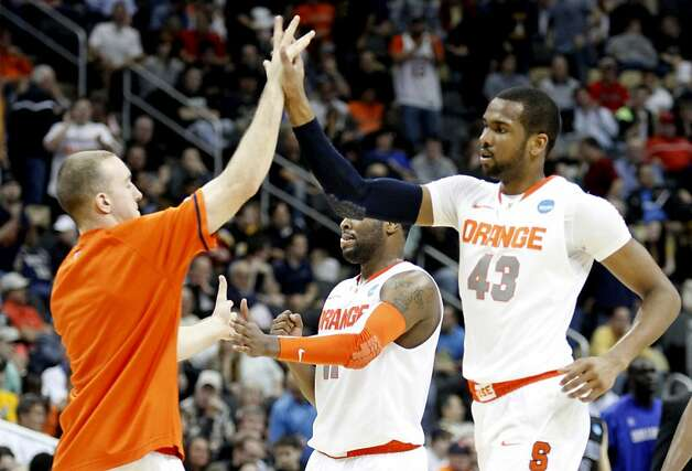 Syracuse's James Southerland is congratulated by a teammate during the second round of the NCAA Men's Basketball Tournament at Consol Energy Center in Pittsburgh, Pennsylvania, Thursday, March 15, 2012. The Syracuse Orange defeated the University of North Carolina Asheville Bulldogs, 72-65. (Jaime Green/Wichita Eagle/MCT) Photo: Jaime Green, McClatchy-Tribune News Service