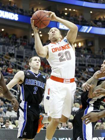 Syracuse's Brandon Triche makes a basket in the final moments against UNC-Asheville during the NCAA Men's Basketball Tournament at Consol Energy Center in Pittsburgh, Pennsylvania, Thursday, March 15, 2012. The Syracuse Orange defeated the University of North Carolina Asheville Bulldogs, 72-65. (Jaime Green/Wichita Eagle/MCT) Photo: Jaime Green, McClatchy-Tribune News Service