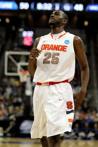 Rakeem Christmas #25 of the Syracuse Orange reacts after a play against the UNC Asheville Bulldogs during the second round of the 2012 NCAA Men's Basketball Tournament at Consol Energy Center on March 15, 2012 in Pittsburgh, Pennsylvania. Photo: Gregory Shamus, Getty Images