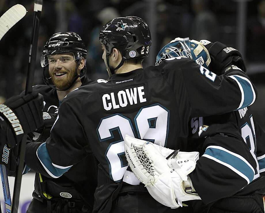 San Jose Sharks' Martin Havlat, left, congratulates Ryane Clowe (29) and goalie Antti Niemi, right, at the end of the NHL hockey game against the Nashville Predators Thursday, March 15, 2012, in San Jose, Calif. (AP Photo/Ben Margot) Photo: Ben Margot, Associated Press