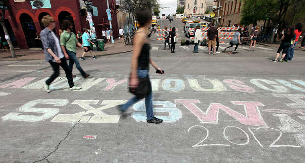 Chalk art on 6th Street during South by Southwest on March 15, 2012 in Austin. Photo: EDWARD A. ORNELAS, Edward A. Ornelas/Express-News / © SAN ANTONIO EXPRESS-NEWS (NFS)