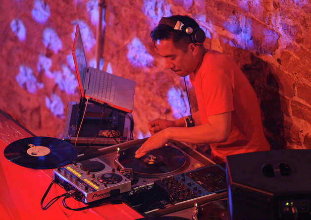 "DJ Jester the Filipino Fist: March 16, 12:05 a.m. at Club de Ville. Alas, our perennial entrant, DJ Jester, ""The Filipino Fist,"" has succumbed to the lure of the West Coast. For years, no matter where Jester was located, he said he was from San Antonio. This year he's from San Francisco. Photo: EDWARD A. ORNELAS, Edward A. Ornelas/Express-News / © SAN ANTONIO EXPRESS-NEWS (NFS)"