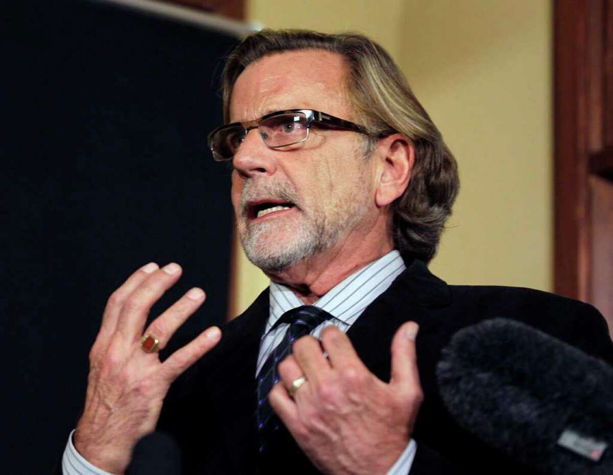 Attorney John Henry Browne talks to reporters, Thursday, March 15, 2012, in Seattle. Browne will be representing the U.S. soldier accused of killing 16 Afghan civilians. (AP Photo/Ted S. Warren)